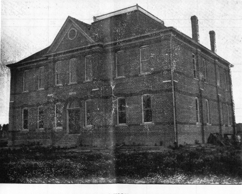 In 1904 a two-story brick school with four rooms was built on four acres donated by Eva and Will Parks east of Mengel R